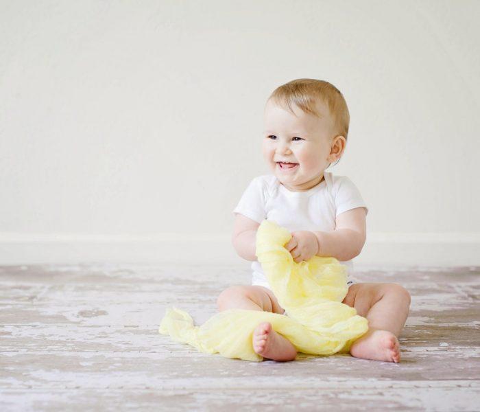 Jak wybrać eleganckie i wygodne ubranko dla maluszka na chrzest?